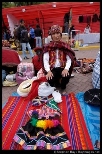 Man selling traditional dress (polleras) for girls.