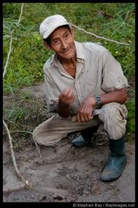 Don Anselmo leads a tour of his farm.