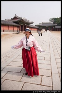 A tour guide speaks to visitors at Changdeok Palace in Seoul, South Korea.