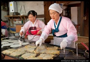These women are preparing haemul pajeon, Korean pancakes filled green onions and seafood.