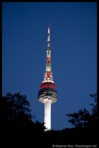 At twilight, N Seoul Tower rises above Namsan Mountain in Seoul, South Korea.