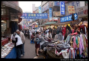 Stores selling shoes, scarves and clothes attract many shoppers at the Namdaemun Market in Seoul.