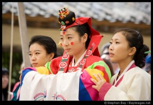 A Korean wedding dress is composed of a short jacket with long sleeves called a jeogori and a full length skirt called a chima.